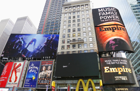 annie: NEW YORK - DECEMBER 18: Broadway signs in Manhattan on December 18, 2014. With over 40 prominent theater houses, Broadway theater is considered one of the world s highest levels of commercial theater