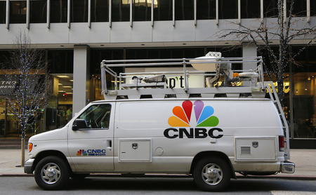 eyewitness: NEW YORK -DECEMBER 18: CNBC truck in Midtown Manhattan on December 18, 2014.The combined reach of CNBC and its siblings is 390 million viewers around the world Editorial