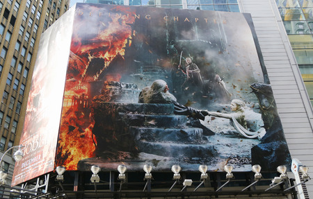 famous industries: NEW YORK - DECEMBER 18 The Hobbit The Battle of the five armies movie premiere billboard on Broadway in Midtown Manhattan on December 18, 2014 Editorial