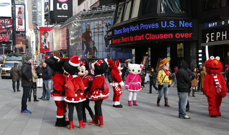 toy story: NEW YORK - DECEMBER 18: Costumed characters at Times Square, greets people and poses for pictures with locals and tourists on December 18, 2014.