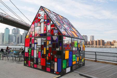 NEW YORK - NOVEMBER 9: Stained glass sculpture by Tom Fruin under Brooklyn Bridge on November 9, 2014. Sculptor Tom Fruin installed his famous plexiglass house, Kolonihavehus, in Brooklyn Bridge Park