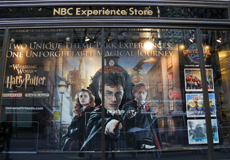 window display: NEW YORK - DECEMBER 18: NBC Experience Store window display decorated with Universal Orlando newest Harry potter theme rides in Rockefeller Center in Midtown Manhattan on December 18, 2014