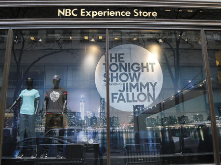 tonight: NEW YORK - DECEMBER 18: NBC Experience Store window display decorated with The Tonight Show with Jimmy Fallon logo in Rockefeller Center in Midtown Manhattan on December 18, 2014 Editorial