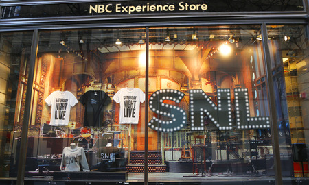 window display: NEW YORK - DECEMBER 18: NBC Experience Store window display decorated with Saturday Night Life show logo in Rockefeller Center in Midtown Manhattan on December 18, 2014