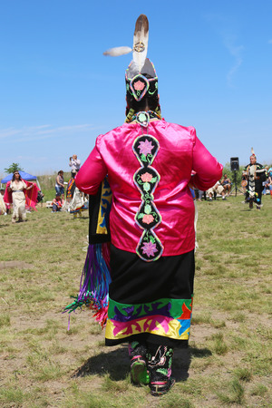 pow wow: NEW YORK - JUNE 8:Unidentified female Native American dancer wears traditional Pow Wow dress during the NYC Pow Wow in Brooklyn on June 8, 2014 Editorial