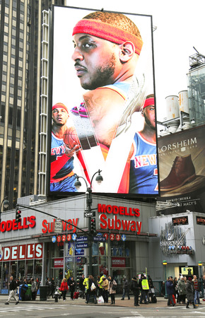 modell: NEW YORK - DECEMBER 18:  New York Knicks professional basketball player Carmelo Anthony on billboard at Modell s sport goods store in Manhattan on December 18, 2014.