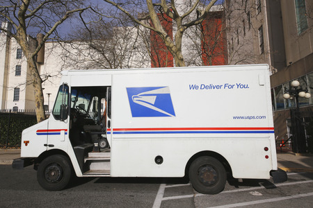 usps: BROOKLYN, NEW YORK - DECEMBER 12: United States Postal Service truck in Brooklyn on December 12, 2014. USPS is the operator of the largest civilian vehicle fleet in the world Editorial
