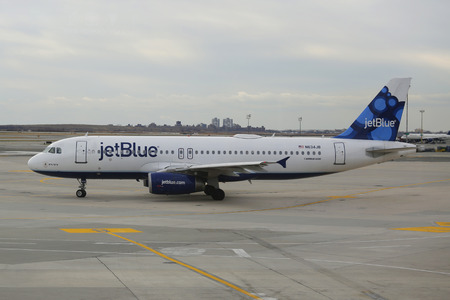 Kennedy: NEW YORK - DECEMBER 30, 2014: JetBlue Airbus A320 aircraft taxing  at John F Kennedy International Airport in New York