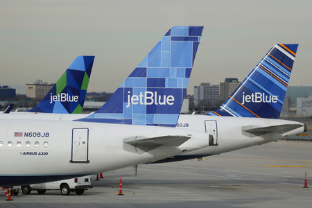 jetblue: NEW YORK - DECEMBER 30, 2014: JetBlue Airbus A320 aircraft at the gates at the Terminal 5 at John F Kennedy International Airport in New York Editorial
