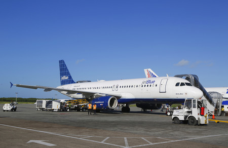 jetblue: PUNTA CANA, DOMINICAN REPUBLIC - DECEMBER 30, 2014: Jetblue Airlines Airbus 320 at Punta Cana International Airport. The Dominican Republic is the most visited destination in the Caribbean Editorial