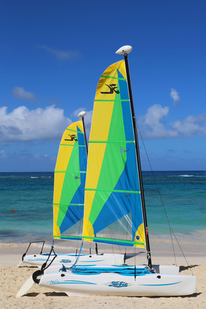 hobie: PUNTA CANA, DOMINICAN REPUBLIC - DECEMBER 31, 2014: Hobie Cat catamaran ready for tourists at Bavaro Beach in Punta Cana. The Dominican Republic is the most visited destination in the Caribbean