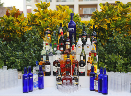 bacardi: PUNTA CANA, DOMINICAN REPUBLIC - DECEMBER 31, 2014: Local and International drinks at the beach bar at Royalton All-inclusive Resort and Casino located at the Bavaro beach in Punta Cana Editorial