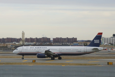 Kennedy: NEW YORK - DECEMBER 30, 2014: US Airways  Airbus A321 aircraft taxing at John F Kennedy International Airport in New York