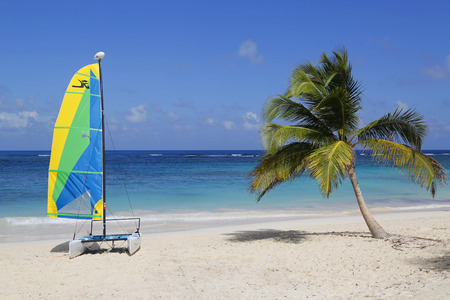 PUNTA CANA, DOMINICAN REPUBLIC - JANUARY 1, 2015: Hobie Cat catamaran ready for tourists at Bavaro Beach in Punta Cana. The Dominican Republic is the most visited destination in the Caribbean
