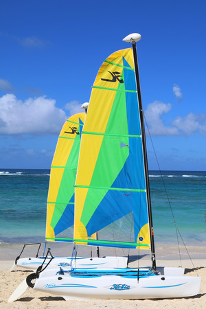 PUNTA CANA, DOMINICAN REPUBLIC - DECEMBER 31, 2014: Hobie Cat catamaran ready for tourists at Bavaro Beach in Punta Cana. The Dominican Republic is the most visited destination in the Caribbean