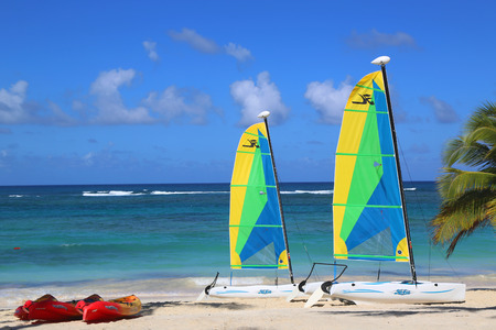 hobie: PUNTA CANA, DOMINICAN REPUBLIC - DECEMBER 31, 2014: Hobie Cat catamarans and sea kayaks ready for tourists at Bavaro Beach in Punta Cana.