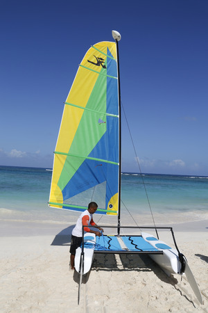 hobie: PUNTA CANA, DOMINICAN REPUBLIC - JANUARY 1, 2015: Hobie Cat catamaran ready for tourists at Bavaro Beach in Punta Cana. The Dominican Republic is the most visited destination in the Caribbean