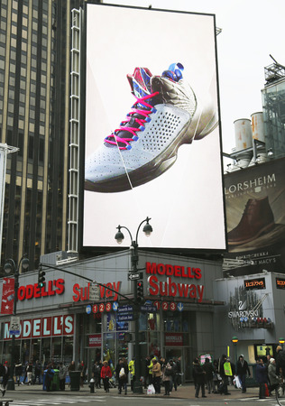modell: NEW YORK - DECEMBER 18: Jordan Flight Plate sneaker on billboard at Modell s sport goods store in Manhattan on December 18, 2014. Editorial
