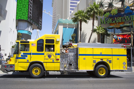 first responder: LAS VEGAS, NEVADA - MAY 10, 2014: Clark County Fire Department Paramedic Truck on Las Vegas Strip.The Clark County Fire Department  provides fire protection and emergency medical services in Nevada