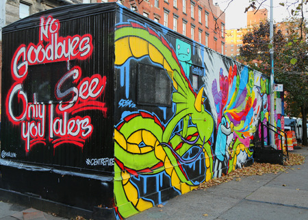 bowery: NEW YORK - NOVEMBER 18, 2014: Trailer painted with mural art at Houston Avenue in Soho. A mural is any piece of artwork painted or applied directly on a wall, ceiling or other large permanent surface