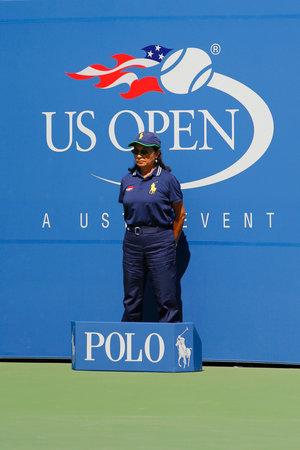 billie: NEW YORK - AUGUST 25, 2014: Line judge during match at US Open 2014 at Billie Jean King National Tennis Center