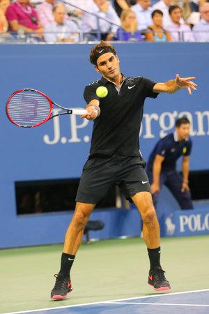 atp: NEW YORK - September 4, 2014: Seventeen times Grand Slam champion Roger Federer during quarterfinal match at US Open 2014 against Gael Monfils at Arthur Ashe Stadium in New York