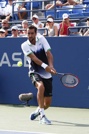 atp: NEW YORK -SEPTEMBER 2, 2014: US Open 2014 champion Marin Cilic from Croatia during round 4 match against Gilles Simon at Billie Jean King National Tennis Center in New York