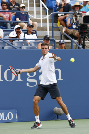 marin: NEW YORK -SEPTEMBER 2, 2014: Professional tennis player Gilles Simon from France  during round 4 match against US Open 2014 champion Marin Cilic at Billie Jean King National Tennis Center in New York