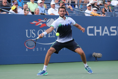 marin: NEW YORK -SEPTEMBER 2, 2014: US Open 2014 champion Marin Cilic from Croatia during round 4 match against Gilles Simon at Billie Jean King National Tennis Center in New York