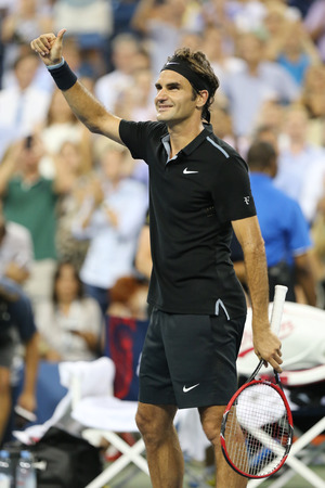 grand slam: NEW YORK - September 2, 2014: Seventeen times Grand Slam champion Roger Federer celebrates victory after round 4 match at US Open 2014 against Roberto Bautista Agut at Arthur Ashe Stadium Editorial