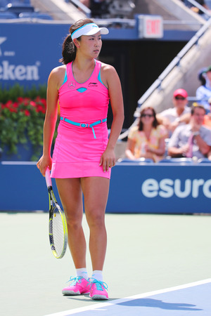september 2: NEW YORK -SEPTEMBER 2, 2014: Professional tennis player Shuai Peng from China during round 4 match against Belinda Bencic at Billie Jean King National Tennis Center in New York
