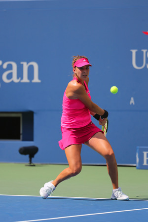 swiss ball: NEW YORK -SEPTEMBER 2, 2014: Professional tennis player Belinda Bencic from Switzerland during round 4 match against Shuai Peng at Billie Jean King National Tennis Center in New York Editorial