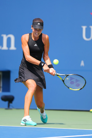 us open: NEW YORK - AUGUST 26, 2014: Grand Slam Champion Ana Ivanovic from Serbia during US Open 2014 first round match against Alison Riske at Billie Jean King National Tennis Center in New York