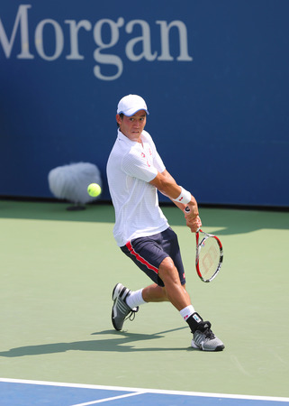 atp: NEW YORK - AUGUST 26, 2014: Professional tennis player Kei Nishikori from Japan during US Open 2014 match against Wayne Odesnik at Billie Jean King National Tennis Center in New York