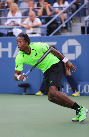 us open: NEW YORK - AUGUST 26, 2014: Professional tennis player Gael Monfis during US Open 2014 first round match  against Jared Donaldson at US Open 2014 at National Tennis Center