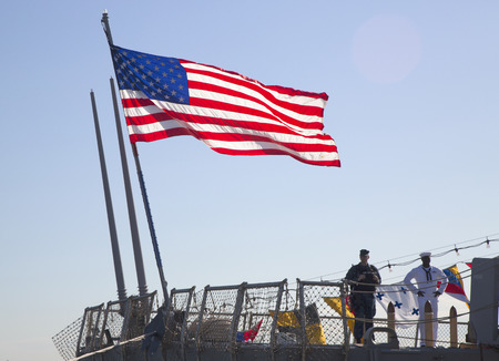 NEW YORK - MAY 25, 2014:  American flag at the USS McFaul guided missile destroyer of the United States Navy during Fleet Week 2014 in New York