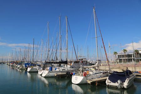 HERZLIYA, ISRAEL - NOVEMBER 25, 2014: Sailing yachts in Herzliya Marina. It s the largest marina in Israel, provides moorings for yachts of all sizes including mega yachts