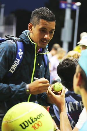 nick: NEW YORK - AUGUST 28, 2014: Professional tennis player Nick Kyrgios from Australia signing autographs after win at US Open 2014 match against Andreas Seppi at Billie Jean King National Tennis Center Editorial