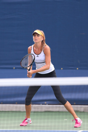 billie: NEW YORK - AUGUST 23, 2014: Professional tennis player Daniela Hantuchova from Slovakia  practices for US Open 2014 at Billie Jean King National Tennis Center in New York