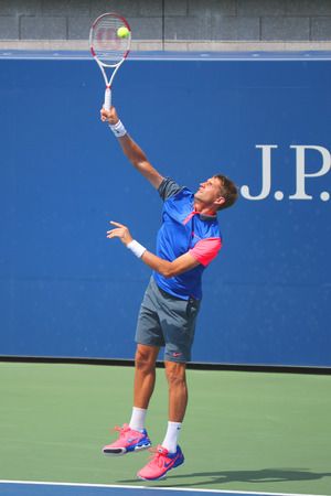 finalist: NEW YORK - AUGUST 31, 2014:  Grand Slam champion Max Mirnyi from Belarus during second round mixed double match at US Open 2014 at Billie Jean King National Tennis Center Editorial