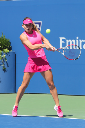 atp: NEW YORK - AUGUST 25, 2014: Professional tennis player Simona Halep during first round match at US Open 2014 against Danielle Rose Collins in New York