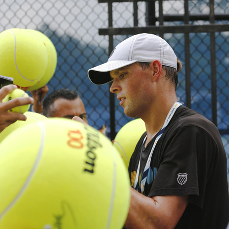 professional practice: NEW YORK - AUGUST 31, 2014: Professional tennis player Mike Bryan signing autographs after practice for US Open 2014 at Billie Jean King National Tennis Center in New York Editorial