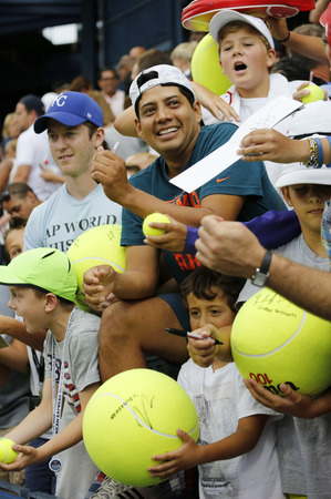 grand slam: NEW YORK - AUGUST 30, 2014: Young tennis fans waiting for autographs at Billie Jean King National Tennis Center in New York. US Open is a final Grand Slam tournament of the year
