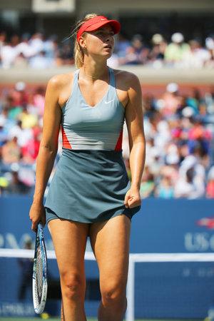 grand slam: NEW YORK- AUGUST 31, 2014: Five times Grand Slam champion Mariya Sharapova during third round match at US Open 2014 against Caroline Wozniacki at Arthur Ashe stadium in New York Editorial