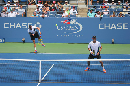 grand slam: NEW YORK -SEPTEMBER 1, 2014: Grand Slam champions Mike and Bob Bryan during US Open 2014 round 3 doubles match at Billie Jean King National Tennis Center in New York Editorial