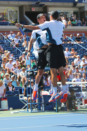 grand slam: NEW YORK -SEPTEMBER 4, 2014: Grand Slam champions Mike and Bob Bryan celebrating victory after semifinal doubles match at US Open 2014 in New York