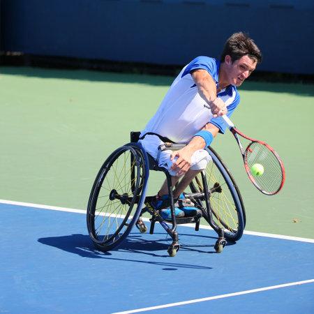 billie: NEW YORK - SEPTEMBER 4, 2014: Tennis player Gustavo Fernandez from Argentina during US Open 2014 wheelchair singles match at Billie Jean King National Tennis Center in New York