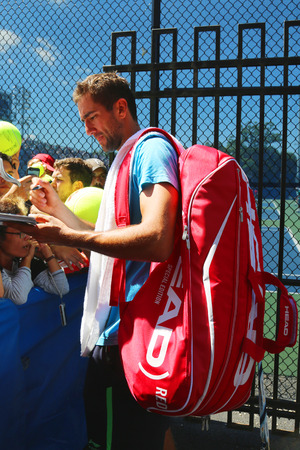 marin: NEW YORK - AUGUST 28, 2014 Professional tennis player Marin Cilic signing autographs after practice for US Open 2014 at Billie Jean King National Tennis Center in New York