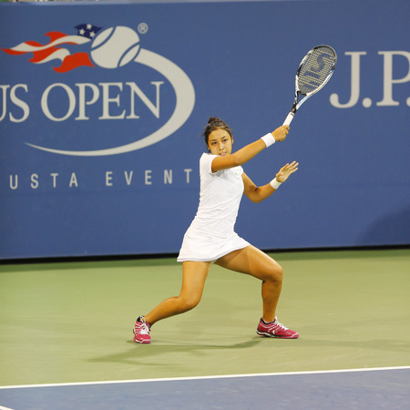 diyas: NEW YORK - AUGUST 28, 2014:  Professional tennis player Zarina Diyas during second round match at US Open 2014 against Catherine Bellis at Billie Jean King National Tennis Center  in New York