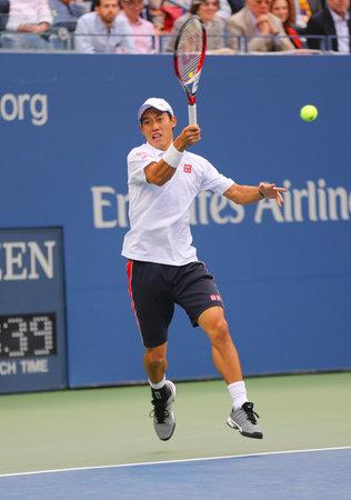 NEW YORK -SEPTEMBER 8, 2014: US Open 2014 finalist Kei Nishikori during final match against Marin Cilic at Billie Jean King National Tennis Center in New York 新聞圖片